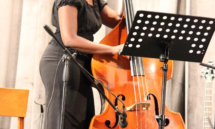 Catherine Karuri playing the double bass.