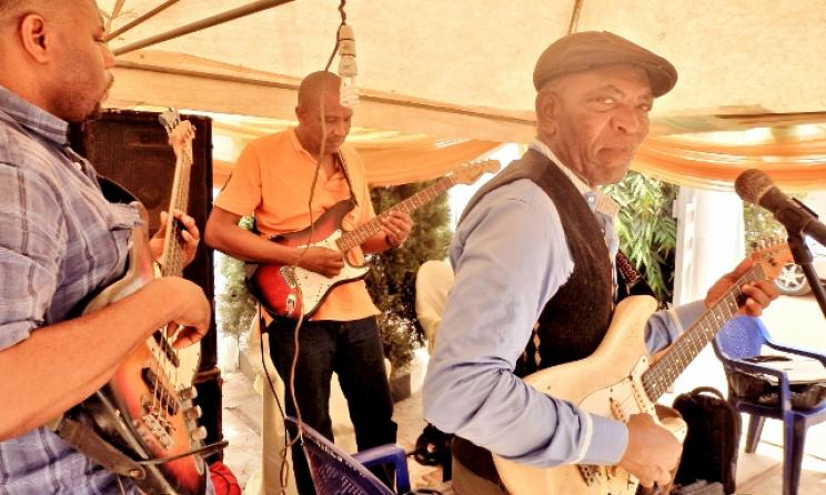 76 year-old Guitar veteran Isaac Onote and other members of the Mayors Band
