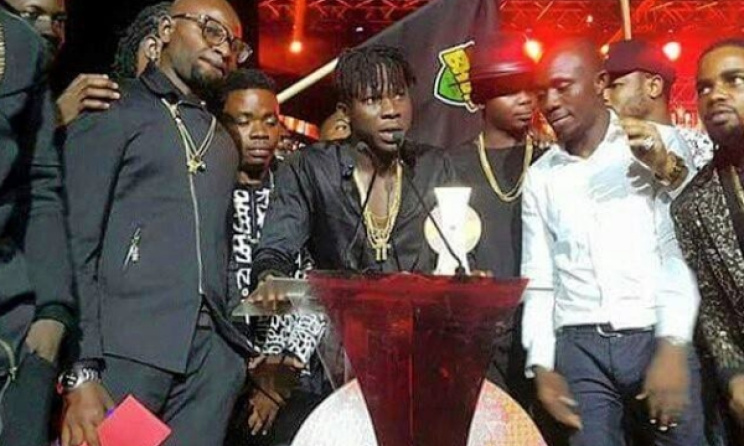 Stonebwoy accepts one of his three awards. Photo: Facebook