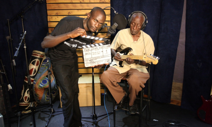 John Nzenze during a recording session. Photo: www.singingwells.org