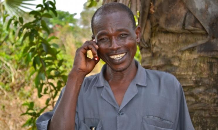 Phone user enjoying services. Photo: www.mercycorps.org.uk