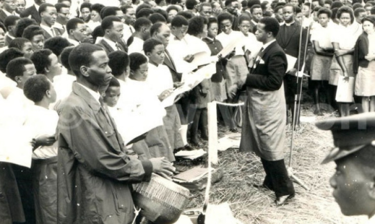 Joseph Kyagambiddwa conducting a choir at Namugongo in the 1960s. Photo: www.newvision.co.ug