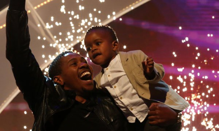 Last year's winner of SA's Got Talent, DJ Arch Jnr. with his proud father. Photo: etv.co.za