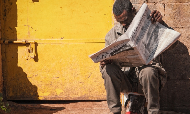 Eritrean newspaper reader. Photo: www.Flickr.com