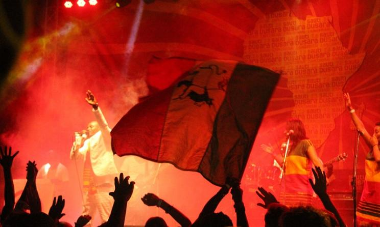 A fan waves a flag during Sami Dan's set.