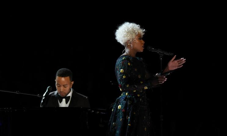 Erivo performing with John Legend at the 2017 Grammys. Photo: Slate