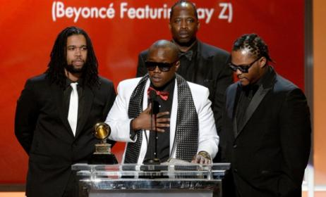 Brian Soko (in white) gives his Grammy acceptance speech.