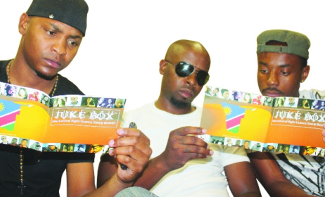 Tosh Tosh, Sunny Boy and Ileni Castro reading the 2011 Mechanical Rights License booklet. Photo: www.namibiansun.com