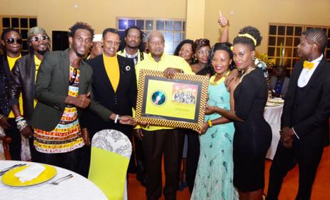 Ugandan artists with President Museveni. Photo: www.chano8.com