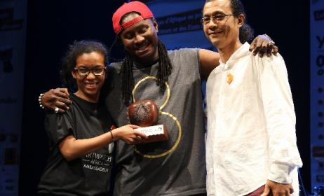 Didier Awadi receives his award from Arterial Network's Diana Ramarohetra and George Camille. Photo: David Durbach