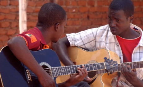 Guitar lessons at Music Crossroads Malawi. Photo: Facebook