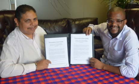 Andre Le Roux and Eddie Hatitye with the MoU between the SAMRO Foundation and the Music In Africa Foundation.