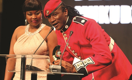 Jah Prayzah accepts one of his NAMA awards while his wife looks on. Photo: www.newsday.co.zw