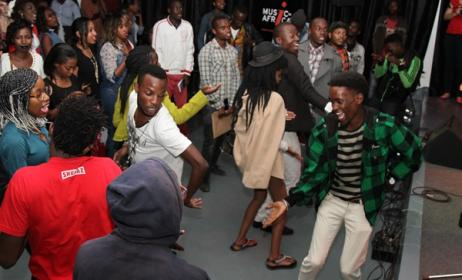 Fans dance at the concert. Photo by Edwin Machuka