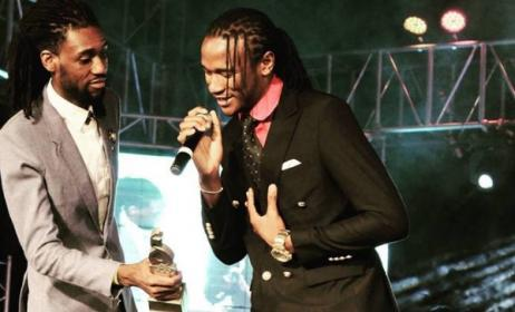 Jah Prayzah accepts one of his four ZIMA trophies from Tendai Manatsa. Photo: ZIMA/Facebook