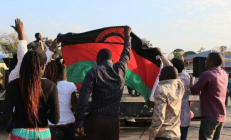 Music fans raise the Malawian flag at the 2014 Ufulu Festival. Photo: Ufulu Festival / Facebook