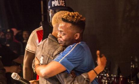 Olamide hugs headliner Reminisce. Photo: Clicks and Tones