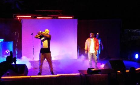 MI Abaga, right, looks on as Loose Kaynon performs.