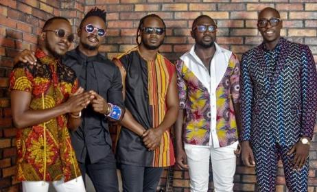 Members of Sauti Sol with Bebe Cool (middle).